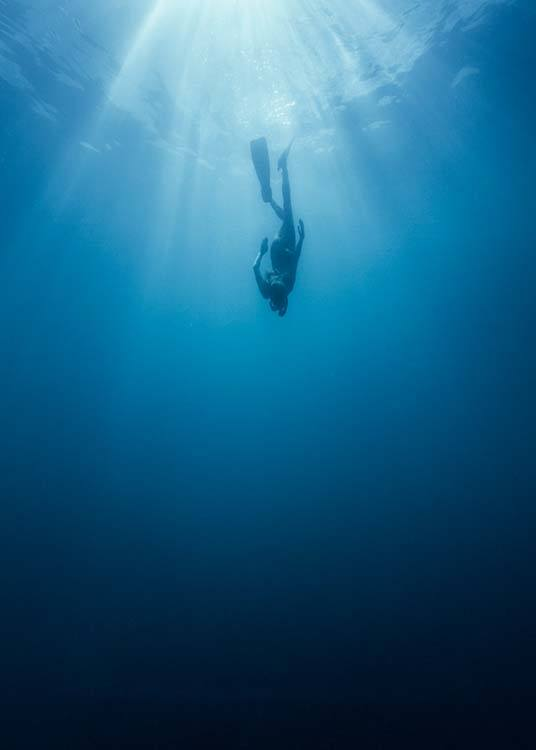 - Poster with an underwater shot of a diver in the indigo ocean.