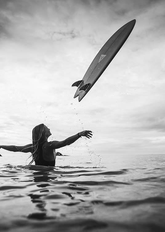 - Great black and white photo poster with a surfer in the water and a surfboard flying through the air.