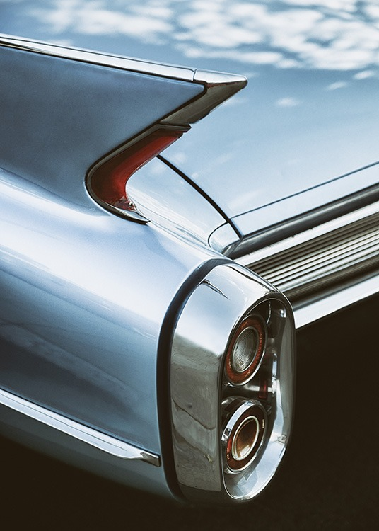 - Retro poster of the rear of a Cadillac with the cloudy sky reflecting on it.