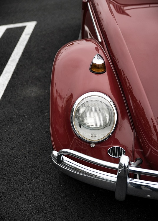 - Vintage poster of an old VW Beetle in red.