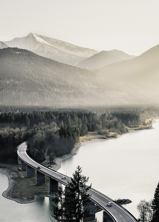 - Photo poster with a view of a high snow-capped mountain and a lake with a road bridge winding through it