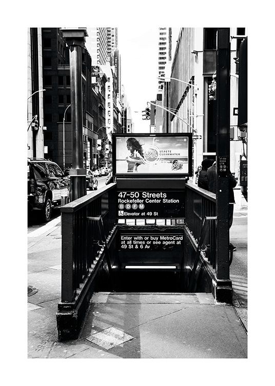 - Black and white poster showing the entrance to the New York subway.