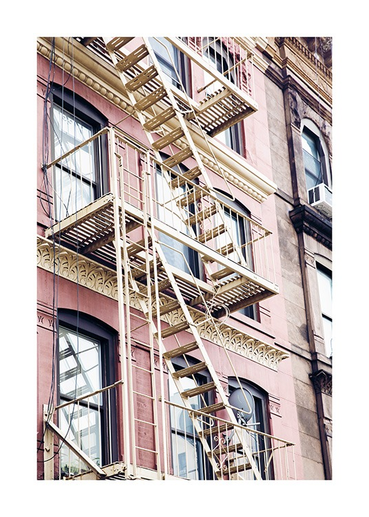 - Photo poster with a fire escape ladder on a pink building facade in New York.