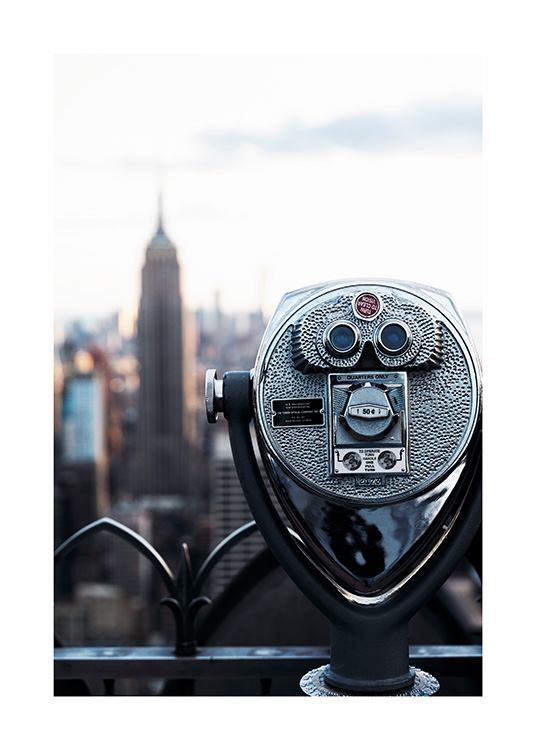 - Photograph of an old telescope in a New York skyscraper and a view of the Empire State Building
