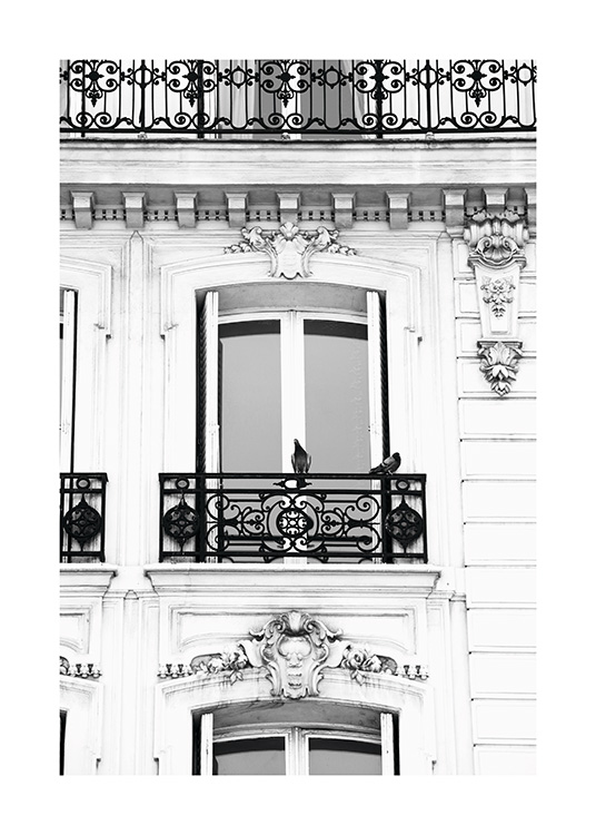 - Beautiful photo of a French balcony on an old ornate building facade.