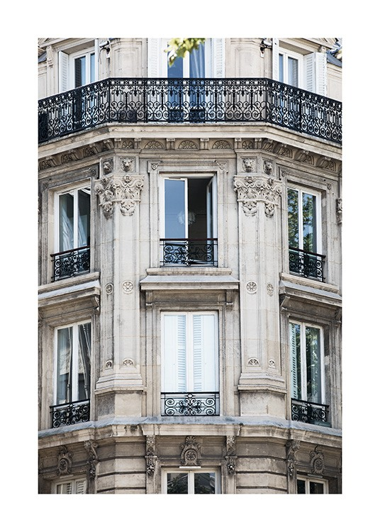 - Beautiful photo showing the intricate details and ornate finish of the outside wall of a building in Paris.