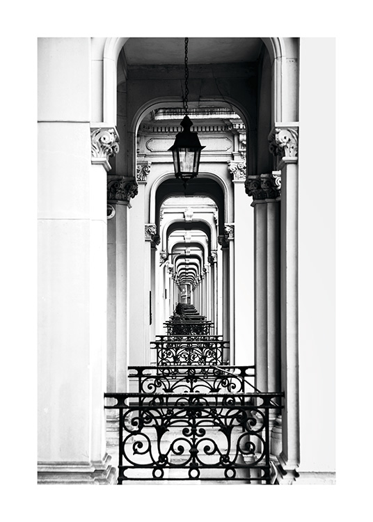 - Black and white photo of old building arches in London, as far as the eye can see.