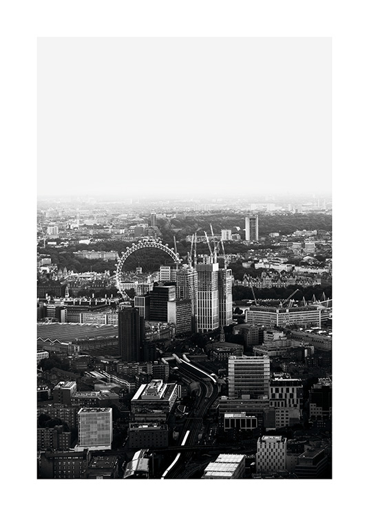 - Black and white aerial shot of London city with the Golden Eye on the River Thames.