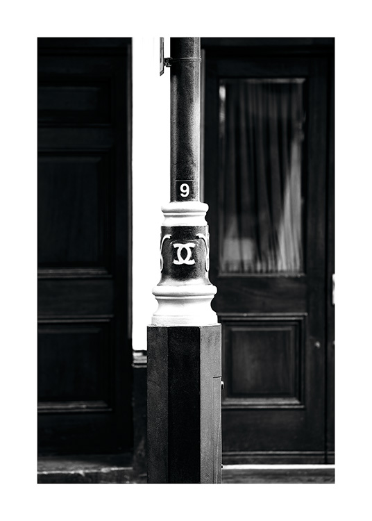"- Black and white London poster showing a lamppost with the inscription ""CC No9""."
