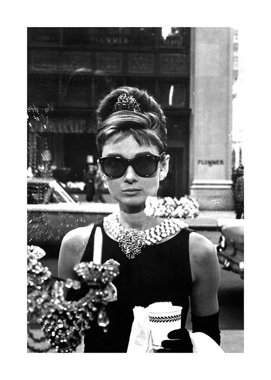 – Black and white photograph of Audrey Hepburn in sunglasses from Breakfast at Tiffany's