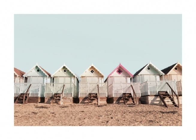 Sandy beach with a brightly coloured row of beach huts
