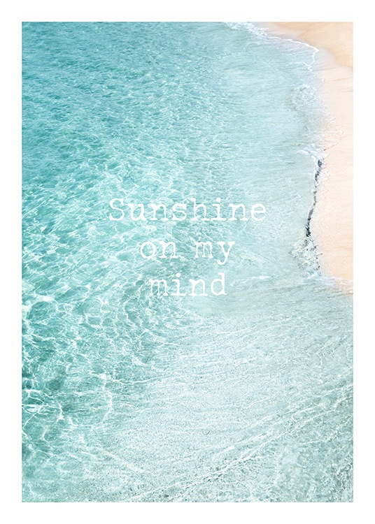 "Clear blue water and light shore with the text ""Sunshine on my mind"""