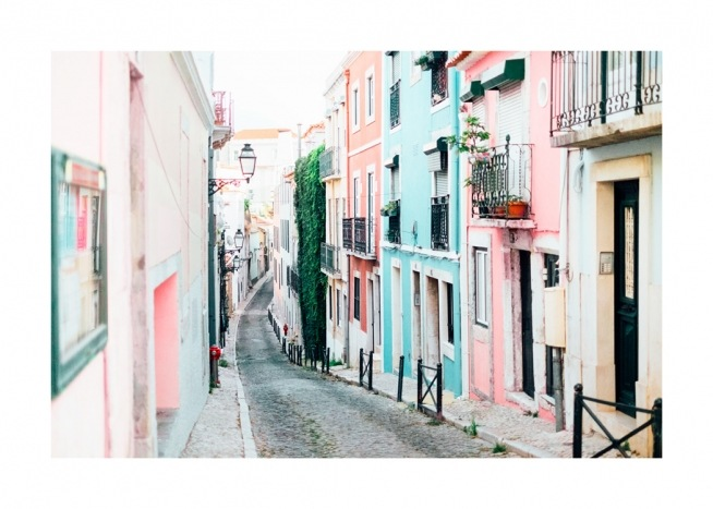 Colourful townhouse in pastel colours on a street in Lisbon, Portugal