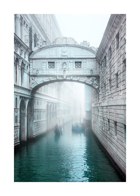 Bridge and canal with mist in the background in Venice, Italy