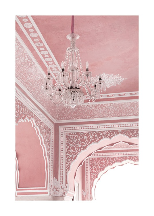 Pink room with chandelier, arches and white details