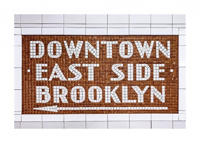 - Tile sign in white and brown with text Downtown East Side Brooklyn and white arrow