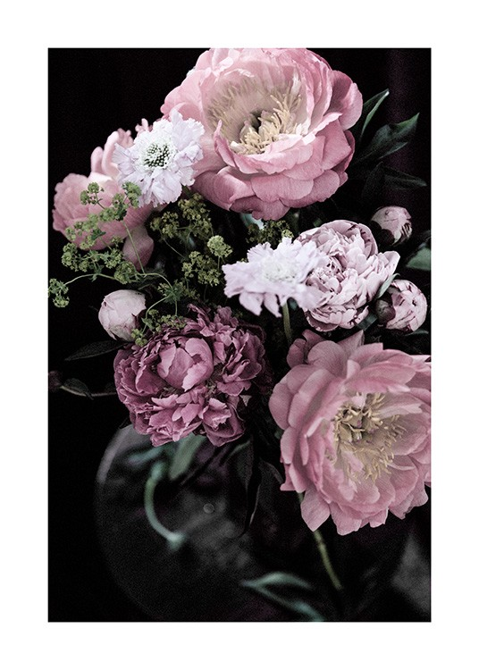 - Bouquet of flowers in pink and purple with greens and a dark background