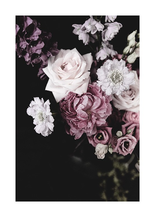 - Dark flower bouquet of pink, purple and white flowers and a dark background