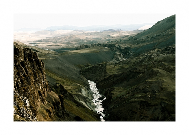 - Photograph of green landscape with mountains and river in Iceland