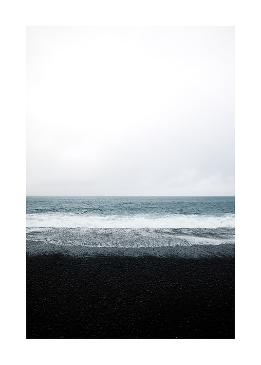 - Photograph of black sand beach and ocean in Iceland