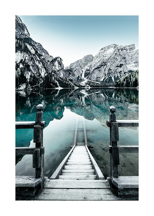 - Nature photograph of snowy mountains behind lake in Braies, Italy, with stairs into the lake