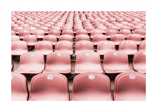 - Photograph from an arena with pink plastic seats in rows