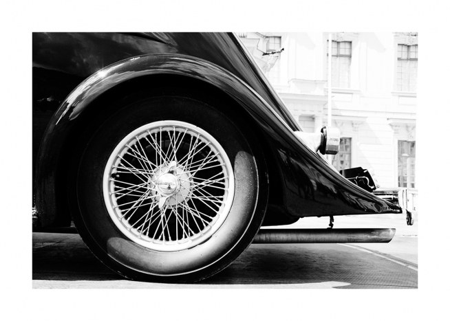 – Black and white photograph of a vintage car wheel