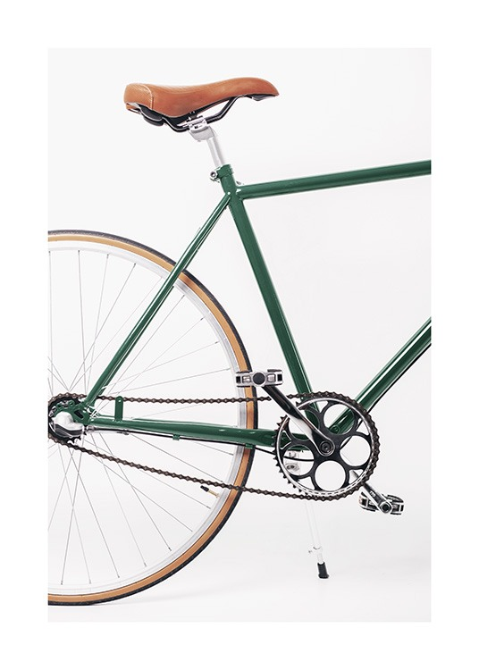 – Photograph of a vintage bike in green with a brown saddle against a white background