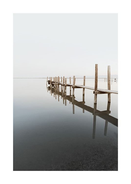 – Photograph of a fishing pier in wood surrounded by still water