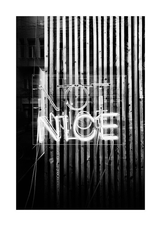 - Black and white photograph of a neon sign with the text Not Nice