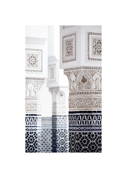 - Photograph of pillars with white and blue patterns