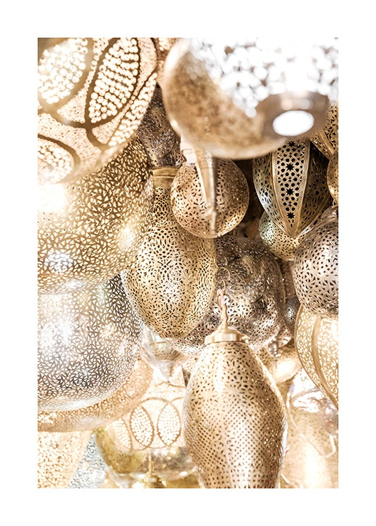 - Photograph of metal, golden lamps in a bunch with patterns on the lamps