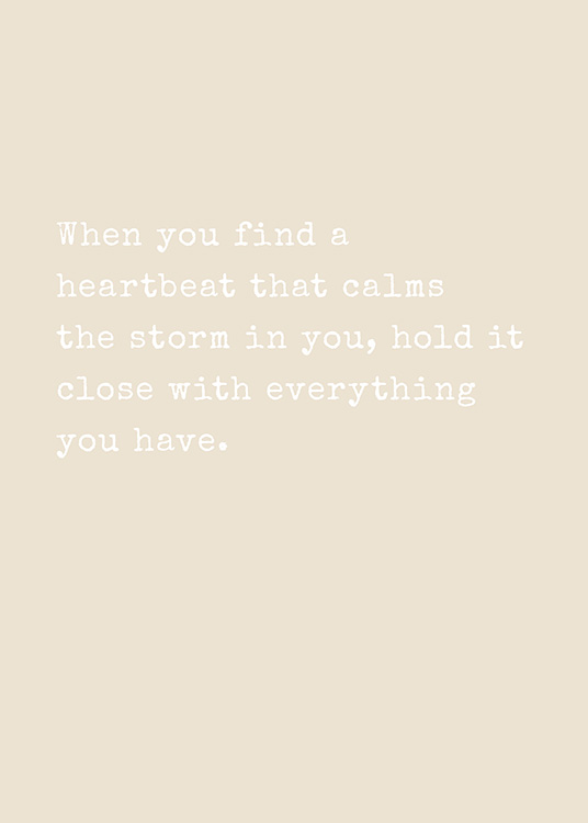 – Text print in white and beige with quote about finding a heartbeat that calms storms inside you