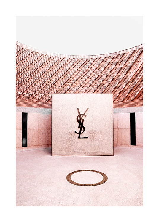 – Photograph of the YSL logo inside a pink room of the YSL Fashion Museum