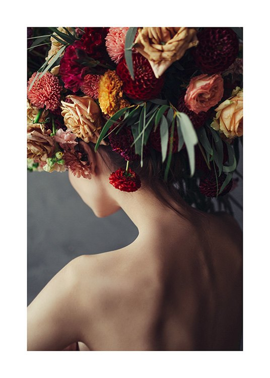 – Photograph of a bunch of yellow and red flowers on a woman's head