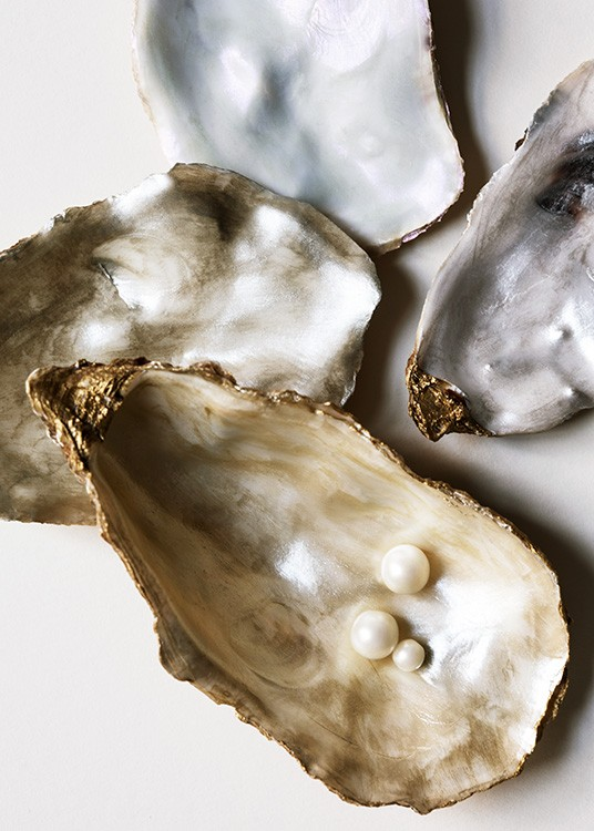 – Photograph of oyster shells in silver and gold with white pearls inside the shell