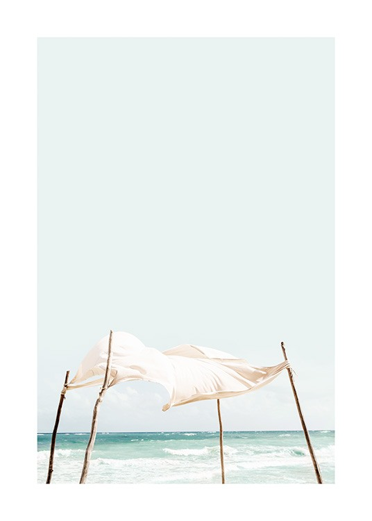 – Photograph of the ocean behind a white fabric flowing in the wind