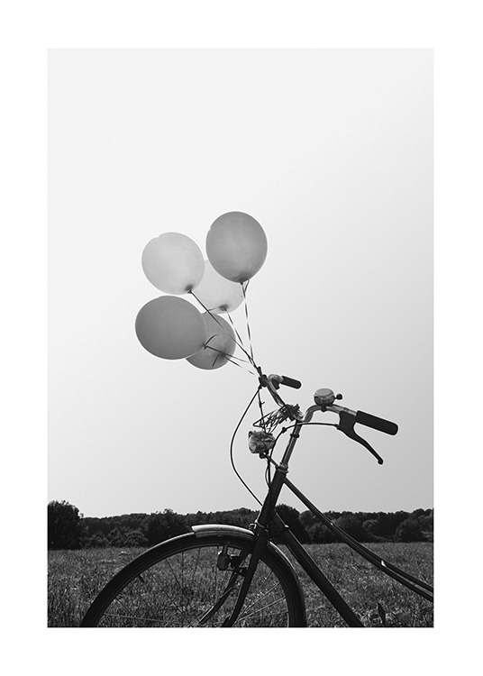 – Black and white photograph of a bike with balloons tied to it