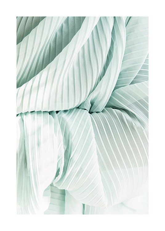 – Photograph of a pleated, sheer fabric in mint green