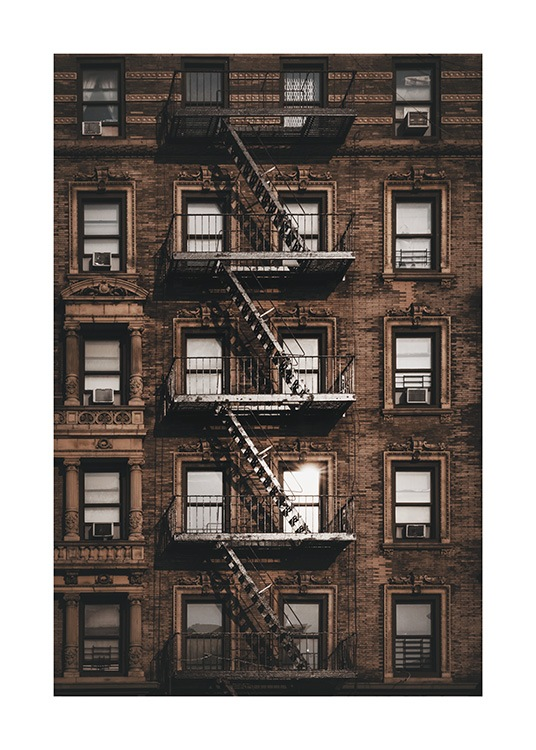 – Photograph of a building in New York with windows and a fire escape