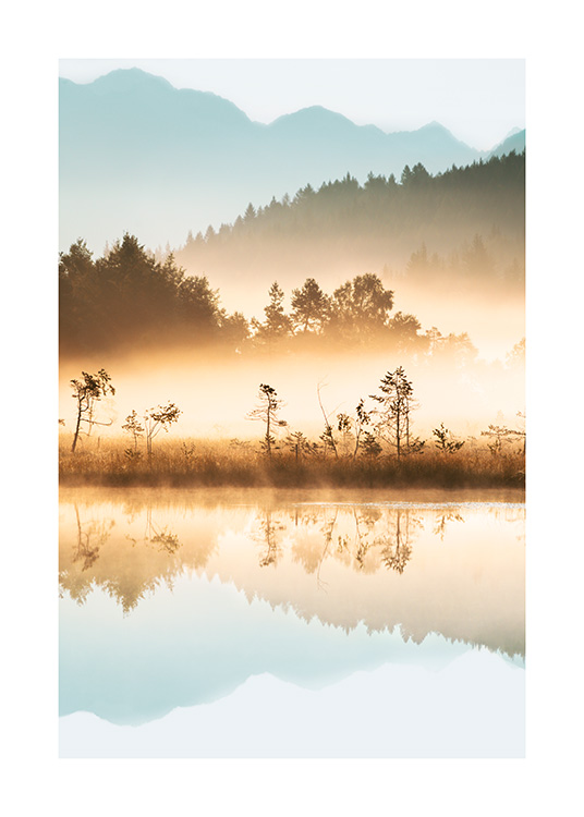 – Photograph of a lake and forest at sunrise with fog over the trees