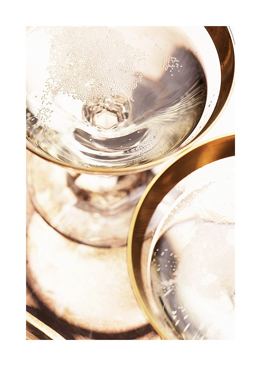 – Photograph with close up of gold rimmed champagne glasses with sparkling champagne