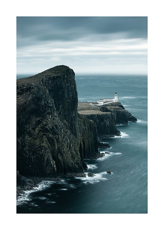 – Photograph of a lighthouse and large cliffs with a stormy ocean next to them