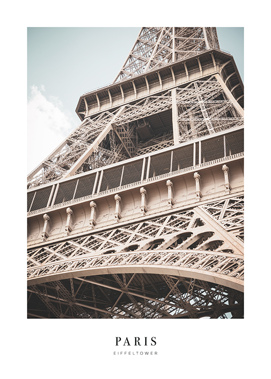 – Photograph with close up of the Eiffel Tower from below, with text underneath it