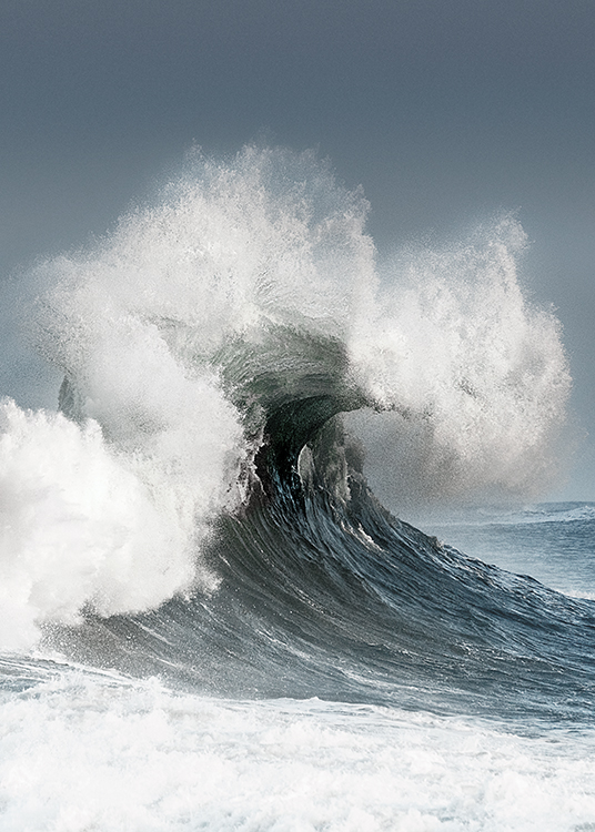 – Photograph of a big wave with a blue sky in the background