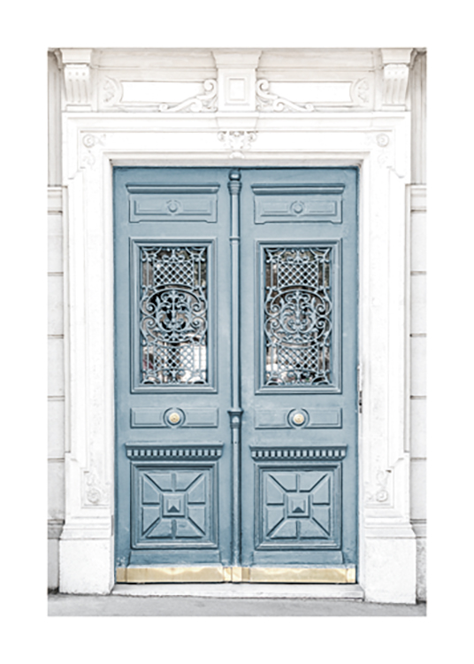 – Photograph of a blue door in a white building, with carvings in the door and the building