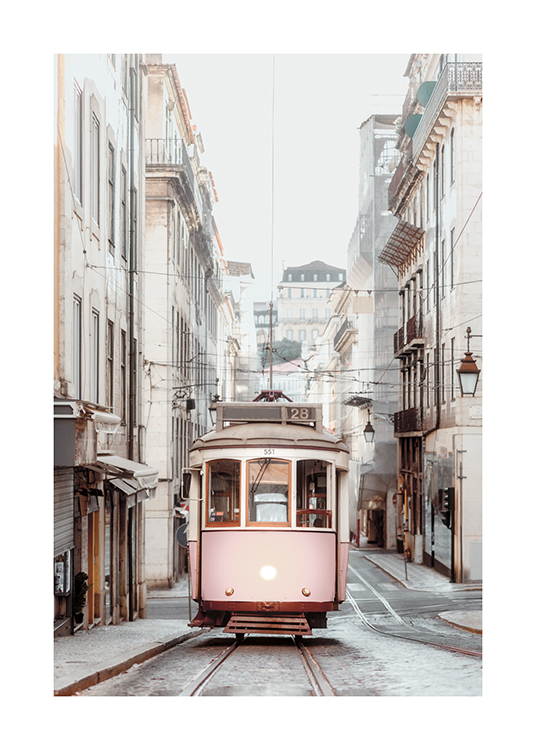 – Photograph of a tram in a vintage style, with buildings on the sides of the street