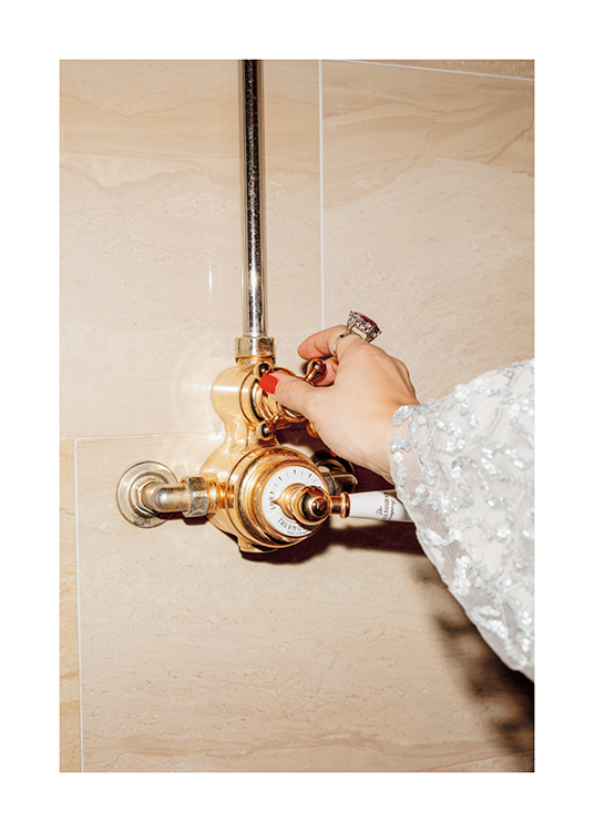 – A woman switching on an old-fashioned gold bathroom shower