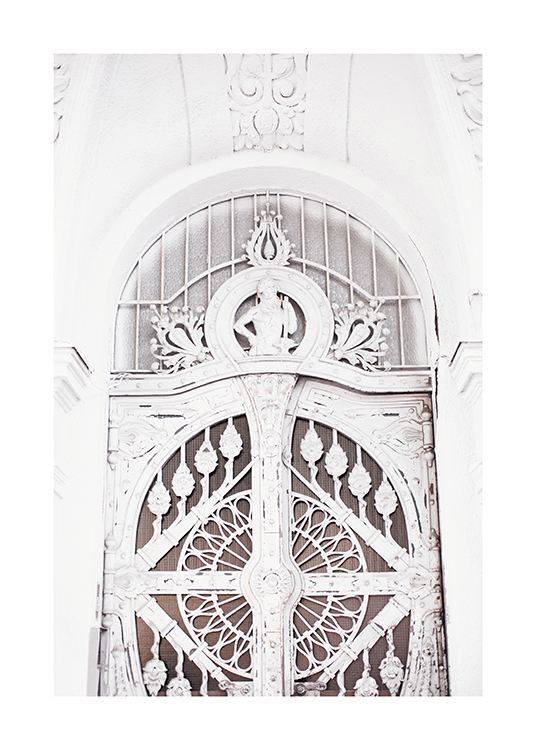 – Photograph of a door in white with detailed carvings