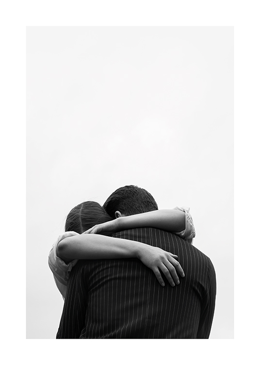 – Black and white photograph of a couple embracing each other